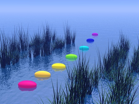 Seven pebbles with chakras colors upon the deep blue ocean and between vegetation, horizon in the background