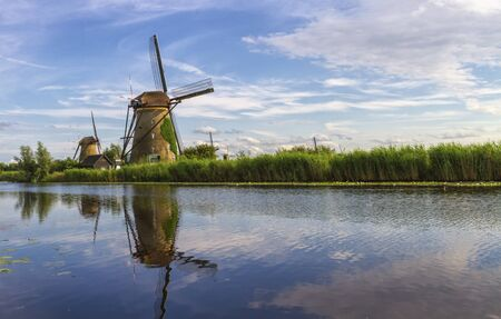 Photo for Windmills in Kinderdijk by day, Holland, Netherlands - Royalty Free Image