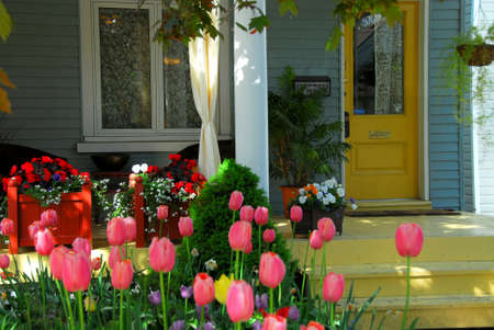 House porch with wicker furniture and flowers
