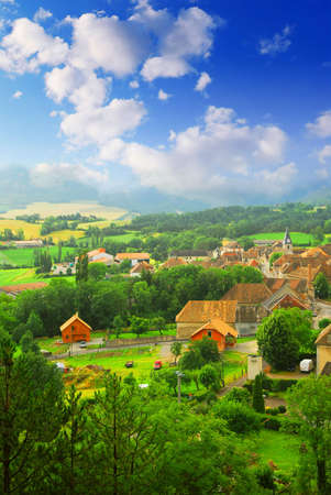 Photo pour Rural landscape with hills and a small village in eastern France - image libre de droit
