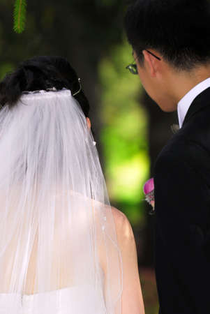 Bride and groom on their wedding day outside