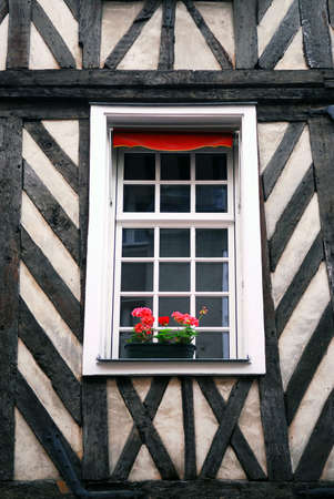 Window in a medieval half-timbered house in Rennes, France.