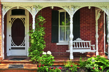 Foto de Beautiful porch of victorian house decorated with flowers - Imagen libre de derechos