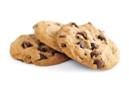 Tall stack of chocolate chip cookies isolated on white background