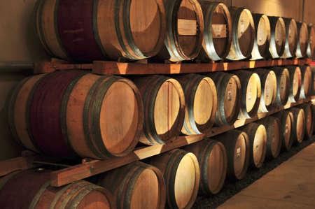Stacked oak wine barrels in winery cellar