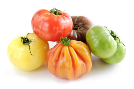 Multi colored heirloom tomatoes isolated on white background