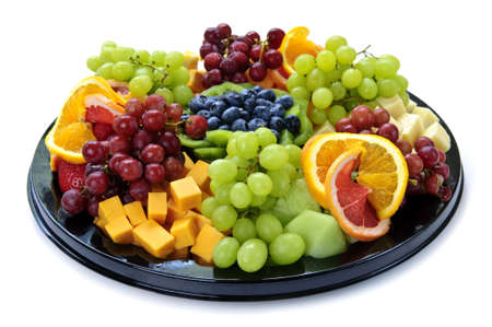 Isolated platter of assorted fruit and cheese