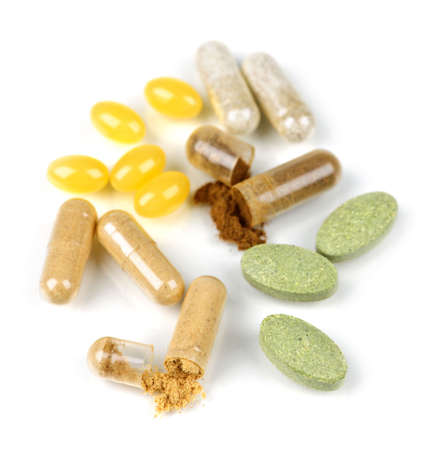 Mix of  herbal supplements and vitamin pills isolated on white