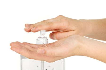 Female hands using hand sanitizer gel pump dispenser