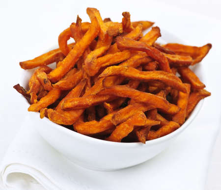 Closeup of sweet potato or yam fries in white bowl