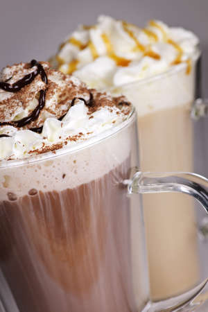Photo pour Hot chocolate and coffee latte beverages with whipped cream - image libre de droit