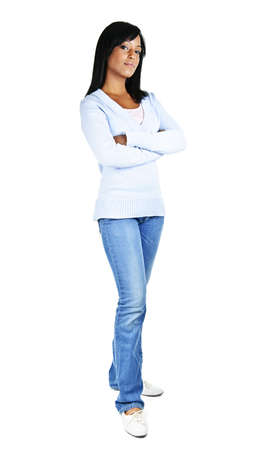 Serious black woman with arms crossed standing isolated on white background