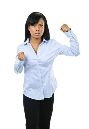 Fighting black woman showing fists isolated on white background