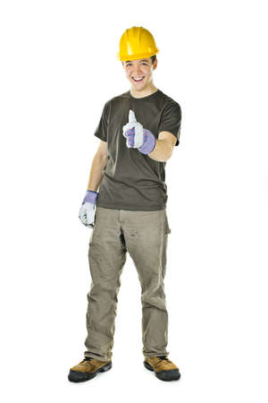 Smiling construction worker showing thumbs up isolated on white background