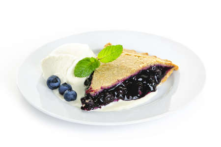Plate with blueberry pie and vanilla ice cream isolated on white background