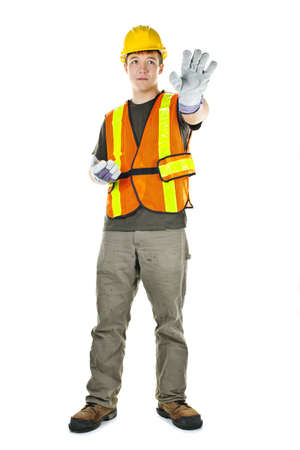 Male construction worker directing with hand signals in vest and hard hat