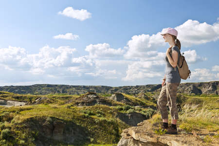 Girl looking at scenic view of the Badlands in Dinosaur provincial park, Alberta, Canada