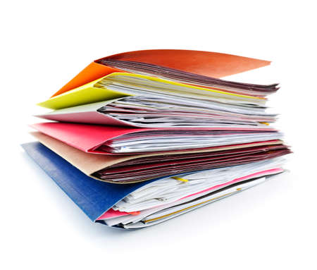 Stack of colorful file folders with papers on white background