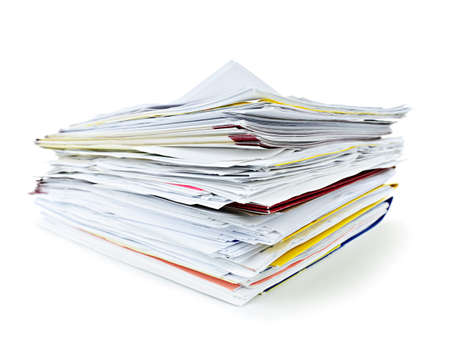 Stack of file folders with papers on white background