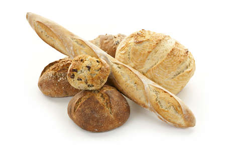 Assorted kinds of bread on white background