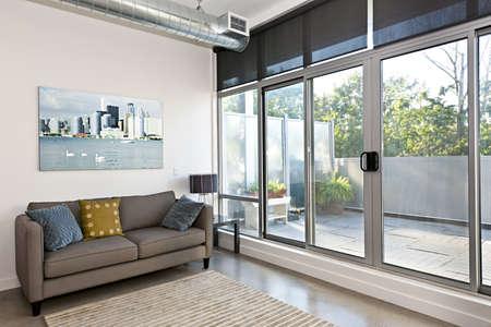 Foto de Living room with sliding glass door to balcony - artwork from photographer portfolio - Imagen libre de derechos