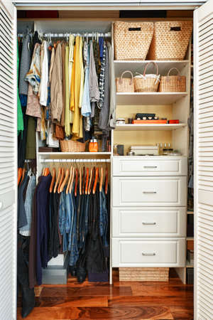 Photo for Clothes hung neatly in organized closet at home - Royalty Free Image