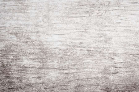 Foto de Gray wooden background of weathered distressed rustic wood with faded white paint showing woodgrain texture - Imagen libre de derechos