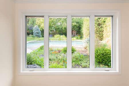 Foto de Large four pane window looking on summer backyard with pool and garden - Imagen libre de derechos