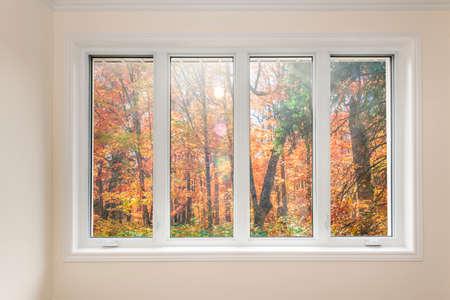 Foto de Large four pane window looking on colorful fall forest - Imagen libre de derechos