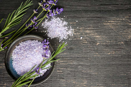 Photo pour Bath salts herbal body care product with fresh lavender on rustic wooden background, copy space - image libre de droit