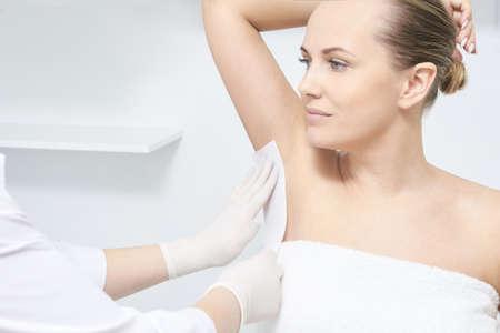Photo pour Unwanted hair wax epilation. Young Woman. cosmetology salon treatment procedure. Home waxing. - image libre de droit