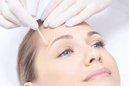 Foto de Waxing woman body. Sugar hair removal. laser service epilation. Salon wax beautician procedure. - Imagen libre de derechos