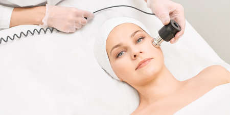 Photo for Electroporation woman face treatment. Facial rejuvenation therapy. Cosmetology skin spa equipment. Rf lifting. Massage device. - Royalty Free Image