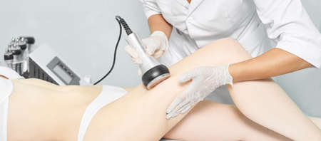 Photo for Cavitation rf body treatment. Female ultra sound lipo machine. Spa contouring. Doctor hands. - Royalty Free Image