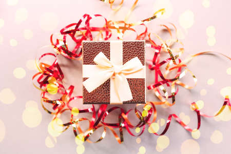 Photo pour Christmas gift box with festive ribbons and golden stars - image libre de droit