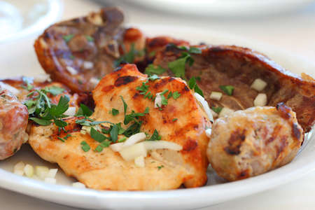 Photo pour Meze meat national Cypriot dish on a plate, beef, pork, grilled chicken.  - image libre de droit