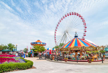Photo for CHICAGO, UNITED STATES - AUGUST 24, 2015: Tourists at the amusement park on Navy Pier - Royalty Free Image