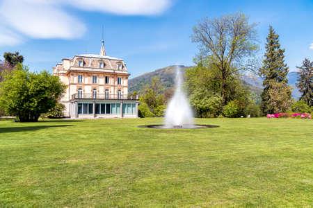 Villa Taranto with a fountain in front, located on the shore of Lake Maggiore in Pallanza, Verbania, Italy.