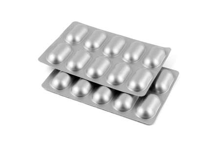 Medicine pills in aluminum foil strip isolated on white background.