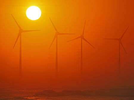 Wind-driven generator and golden sunset
