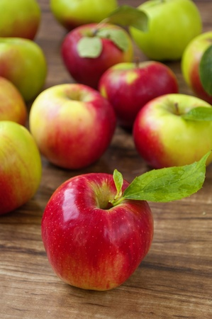 red and green apples on a wooden background