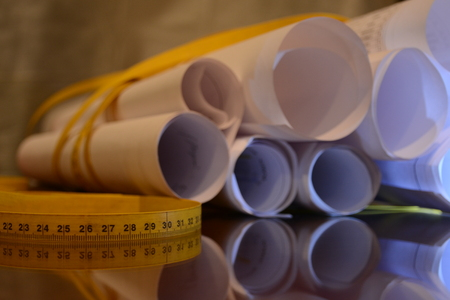 project rolled papers with tape measure around 12