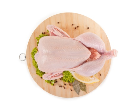 Fresh raw chicken and condiments, high angle view, clipping path included