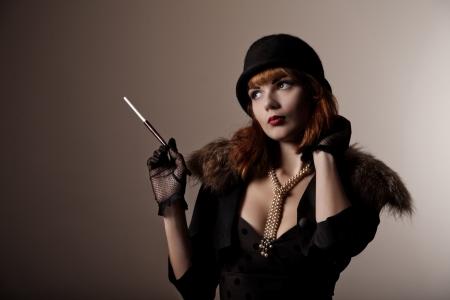 Artistic shot of beautiful retro woman in hat