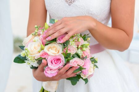 Photo for Hands are not on a bouquet of white roses. - Royalty Free Image