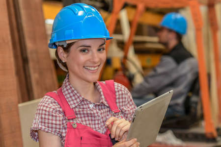 Photo pour Workers check the stock in a carpentry - image libre de droit