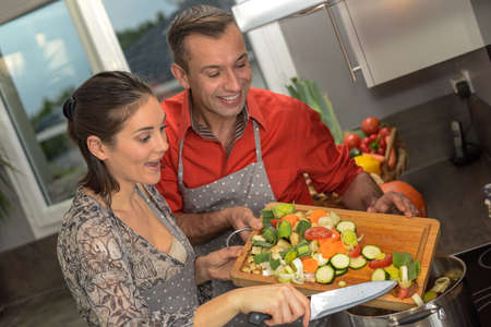 Photo for vegetarian couple preparing their meal - Royalty Free Image