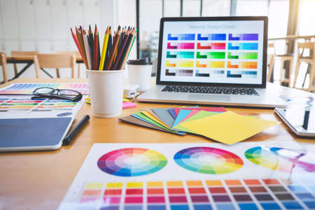 Photo for Graphic designer object tool and color swatch samples at workspace. - Royalty Free Image