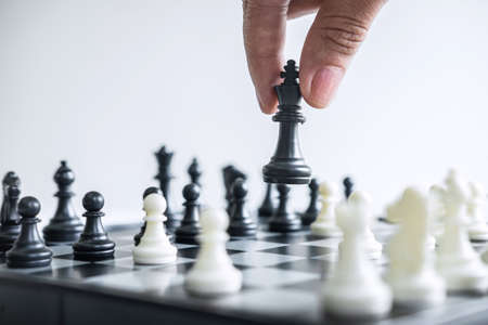 Photo for Business woman playing chess and thinking strategy about crash overthrow the opposite team and development analysis for win and successful. - Royalty Free Image