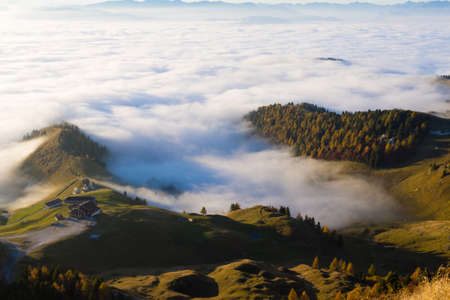 Panorama from Italian alps, carpet of clouds and peaks. Top mountain landscape